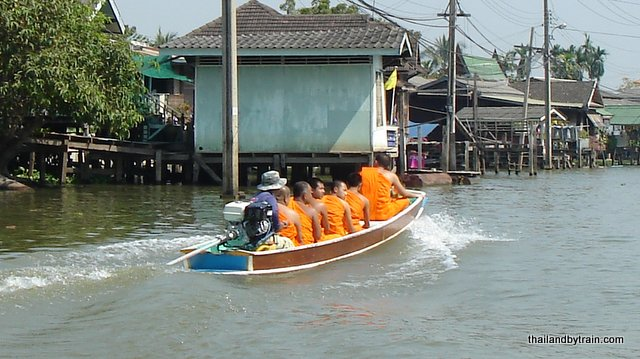 Monks travelling by boat, Koh Kret